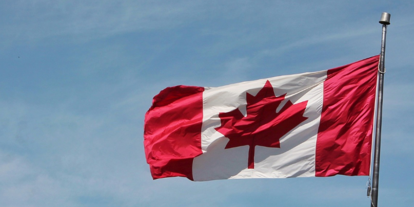Canadian Flag Against Blue Sky.png