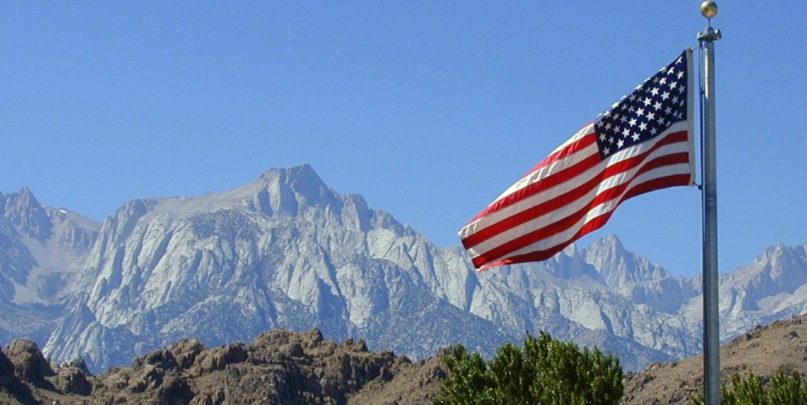 USA Flag With Mountain Backdrop.png